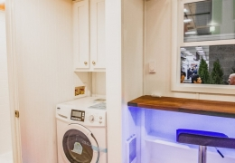 Optional washer/ dryer combination unit with storage cabinets above in the Little Tahoma Peak
