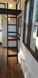 Dark stained ladder in the Lincoln Peak to math interior trim