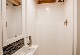"A 36"" shower and petite sink shown in the bathroom of a Little Tahoma Peak"
