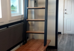 Custom metal and wood storage bench and stationary ladder in the Castle Peak