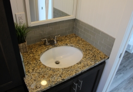 Bathroom with granite counter and undermount sink