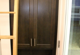 Entry storage cabinet with shoe cubbies in dark alder