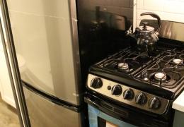 Apartment sized refrigerator and propane range