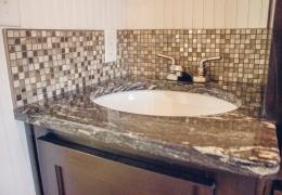 Castle Peak bathroom with granite countertop and glass bead backsplash